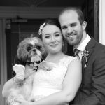 Jess and Joe on the wedding day with their dog Mia.